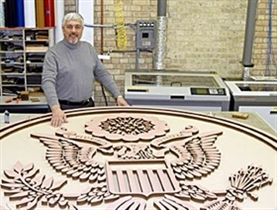 Milwaukee sign and display manufacturer, founded and owned by bulgarian George Mladenov, creates oversized seal for Obama's inaugural